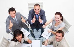 Exuberant business team with thumbs up Royalty Free Stock Photo