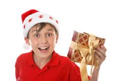 Exuberant child with Christmas gift Royalty Free Stock Photo