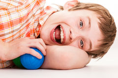 Exuberant child laying on side Stock Image