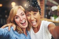 Exuberant happy multi ethnic girl friends Stock Image