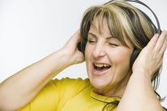 Exuberant met hoofdtelefoons royalty-vrije stock afbeelding
