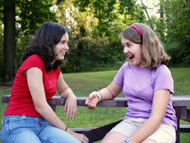 Exuberant sisters. Teen sisters having an animated talk Royalty Free Stock Images