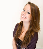 Exuberant young brunette woman. Royalty Free Stock Image