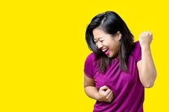 Exuberant young Chinese woman cheering royalty free stock photo
