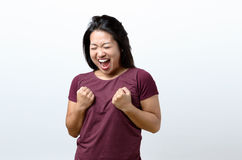 Exuberant young Chinese woman cheering Royalty Free Stock Photos
