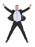 Exultant веселить бизнесмена Стоковая Фотография