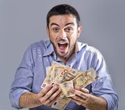 Exultant Young Man holding Banknotes Stock Photo