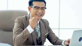 The Exulting Businessman gets excited when finally success Royalty Free Stock Photo
