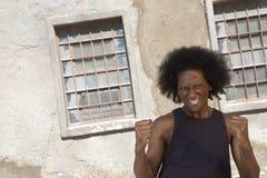 Exzentermann mit Afro Stockfotografie
