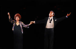 Eydie Gorme and Steve Lawrence. Pop icons Eydie Gorme and Steve Lawrence perform at the Chicago Theater in Chicago, Illinois in February of 1983.   Gorme, a Stock Photography