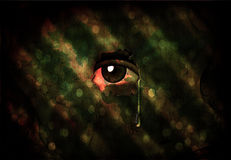 Eye. Peers through Wall with Tear Royalty Free Stock Photo