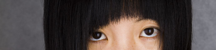 Eye. A chinese girl stare at the lens Royalty Free Stock Photos