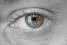 Eye. Close up of an eye pertially desaturated Royalty Free Stock Photography