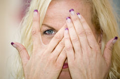 Eye behiind hands Royalty Free Stock Photo