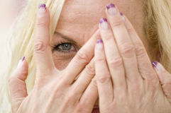 Eye Behind Fingers Royalty Free Stock Photography