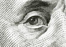 Eye of Benjamin Franklin. On 100 dollar bill royalty free stock photos