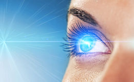 Eye on blue background Royalty Free Stock Photo