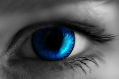 Eye in blue lens, blurred at the edges royalty free stock images
