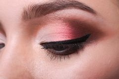 Eye with bright makeup closeup, model face crop Royalty Free Stock Image