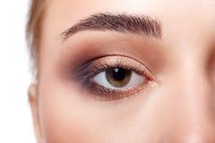 Eye with bright makeup closeup, model face crop Stock Photos