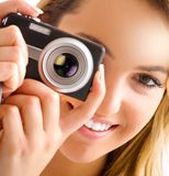 Eye and camera. Blond women portrait with camera and hat