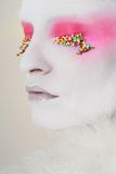 Eye candy. Hundreds and thousands and pink eyeshaddow, sweets Stock Photos