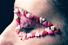 Eye Candy. Candy applied as eye makeup on a young woman Royalty Free Stock Photo
