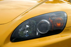 Eye Of A Car. Head light of a yellow sports car Stock Photos