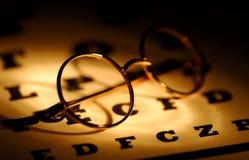 Eye Care. Eyeglasses on an Eyechart With Creative Lighting Stock Images