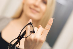 Eye care - choice between glasses and contacts. Concept Stock Photography