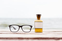 Eye care concept with glasses and medicine bottle Stock Images