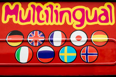Eye-catching red Multilingual sign Stock Image