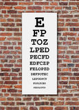 Eye Chart On Brick Wall Royalty Free Stock Photography