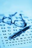Eye chart test. Pen and black glasses on eye chart test stock photo