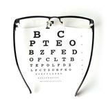 Eye chart test. Eye glass with test chart on white background Royalty Free Stock Photo