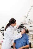 Eye Checkup With Phoropter Stock Photo