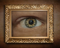 Eye with clock in frame. Surreal concept graphic. Royalty Free Stock Photography