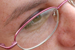 Eye close-up. Close-up of girls eye in glasses Stock Photography