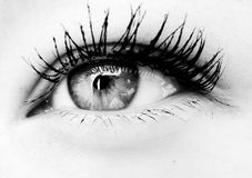 Eye close-up in b&w. Close-up of an female eye in black and white Stock Photo