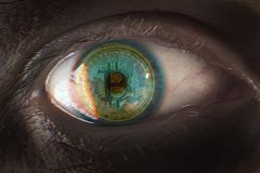 Eye close-up with bitcoin reflection stock images