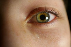 Eye closeup with tear Stock Photos