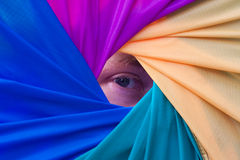 Eye within a colored vortex. Eye sitting in between a collection of four colors formed from an exotic kite Royalty Free Stock Photography