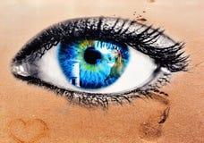 Eye concept on the beach Stock Photos