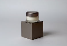 Eye cream container and box Royalty Free Stock Images