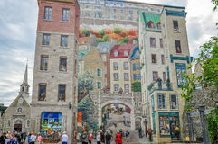 Eye deceiving mural in Old Quebec City, Canada. Quebec City, Canada -September 19, 2012: `La Fresque des Quebequois` is an eye deceiving mural in Old Quebec City Royalty Free Stock Photography