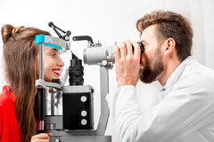 Eye doctor checking vision stock image