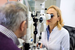 Eye doctor checkup eyes with apparatus Stock Photos