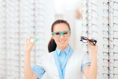 Eye Doctor Comparing Contacts to Eyeglasses for Vision Correction stock image
