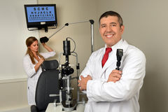 Eye Doctor and Essistant in Examination Room Royalty Free Stock Images