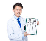 Eye doctor with eyesight test Royalty Free Stock Image